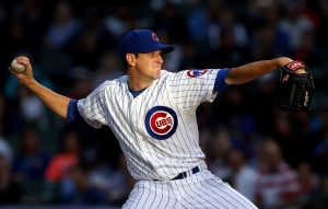 Aug 12, 2014; Chicago, IL, USA; Chicago Cubs starting pitcher Kyle Hendricks throws a pitch against the Milwaukee Brewers in the first inning at Wrigley Field. Mandatory Credit: Jerry Lai-USA TODAY Sports